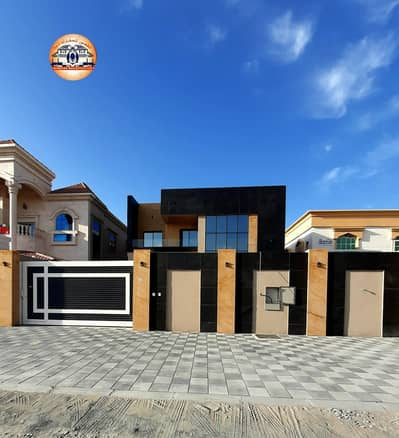 5 Bedroom Villa for Sale in Al Rawda, Ajman - Owning a lifetime villa owns the life span for you and your children without an advance payment with the best banking facilities Super deluxe finishing and faced with a stone Owning all nationalities