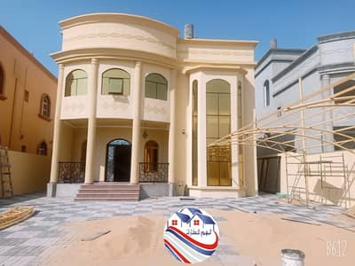 5 Bedroom Villa for Sale in Al Rawda, Ajman - Villa, sophisticated design, high finishes, distinctive location, spacious areas, for sale without down payment for installments through the bank for a period of 25 years with the lowest monthly installment
