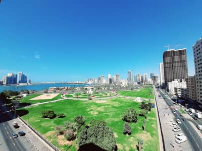 3 Bedroom Apartment for Rent in Corniche Al Buhaira, Sharjah - AC Free Huge 3BR Apartment with Amazing View Big Balcony and Facilities