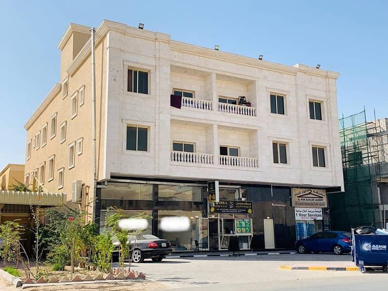 بناية تشطيب سوبر ديلوكس للبيع في منطقة المويهات بإمارة عجمان علي الشارع العام
