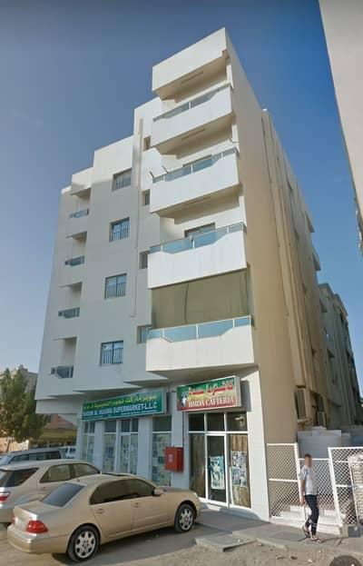 8 Bedroom Building for Sale in Al Nuaimiya, Ajman - Building for sale in Ajman Al Nuaimia, ground and 4 on two distinct streets