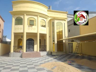 5 Bedroom Villa for Sale in Al Rawda, Ajman - For sale, an Arabic-designed villa with a large building and land area, with the possibility of buckling financing
