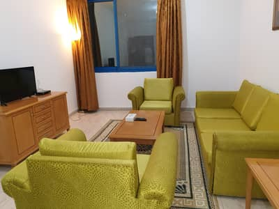 1 Bedroom Apartment for Rent in Tourist Club Area (TCA), Abu Dhabi - Living Room