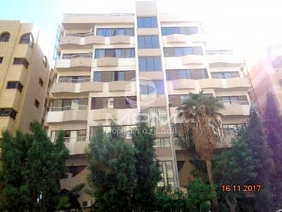 2 Bedroom Apartment for Rent in Tourist Club Area (TCA), Abu Dhabi - Window AC | Balcony | 4 Chqs | Tourist Club Area