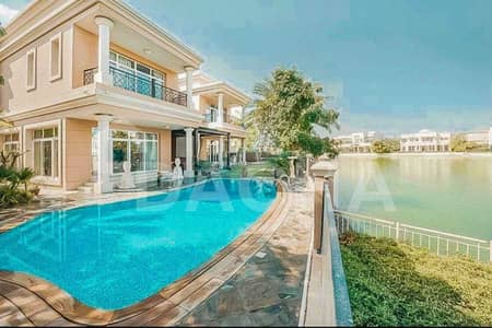 6 Bedroom Villa for Sale in Emirates Hills, Dubai - Charming Lake View Villa / 6 Beds / Vacant