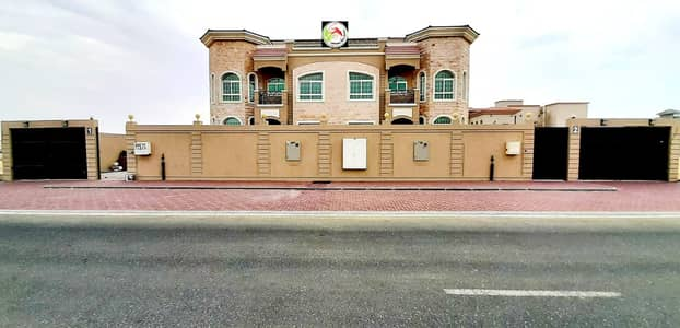 6 Bedroom Villa for Sale in Hoshi, Sharjah - For sale two adjacent villas at a snapshot price, personal finishing, one stone face entirely, the best European decorations and designs, American central air conditioning, a very privileged location, a main qar street