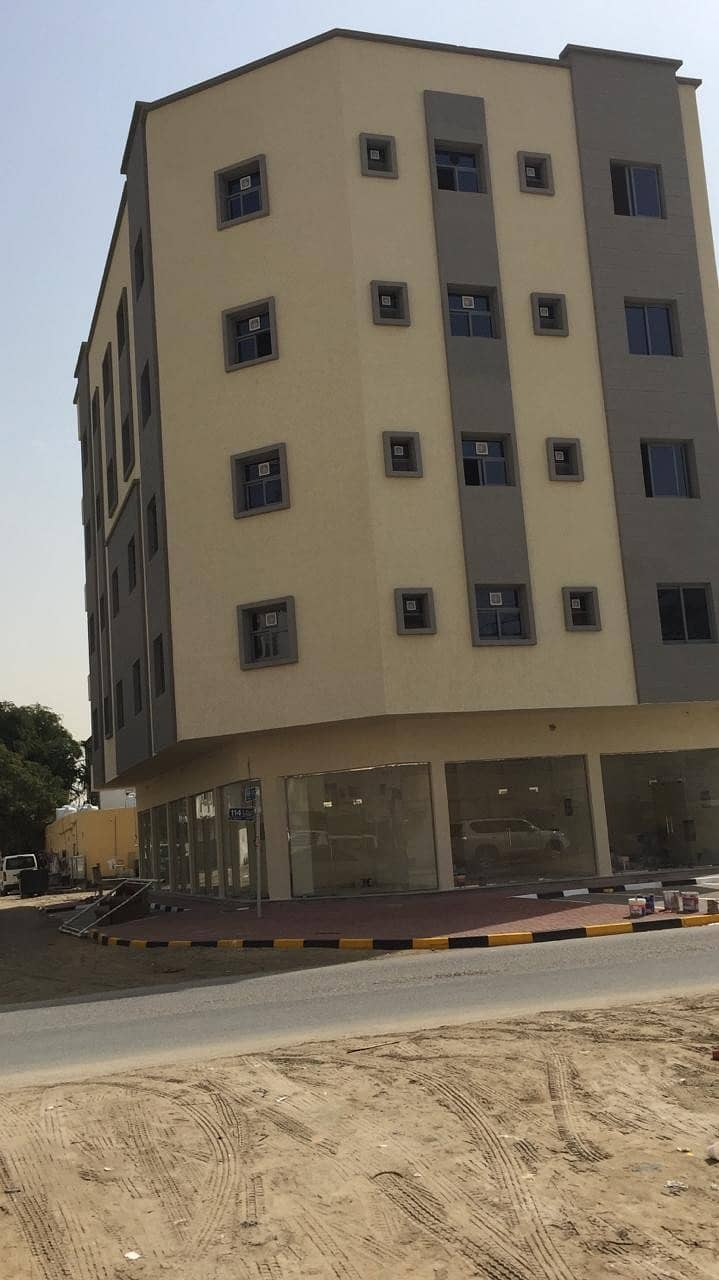 For sale, residential, commercial building, corner of three streets, in a very distinctive location, close to Ajman Port, Liura area, with a very special income