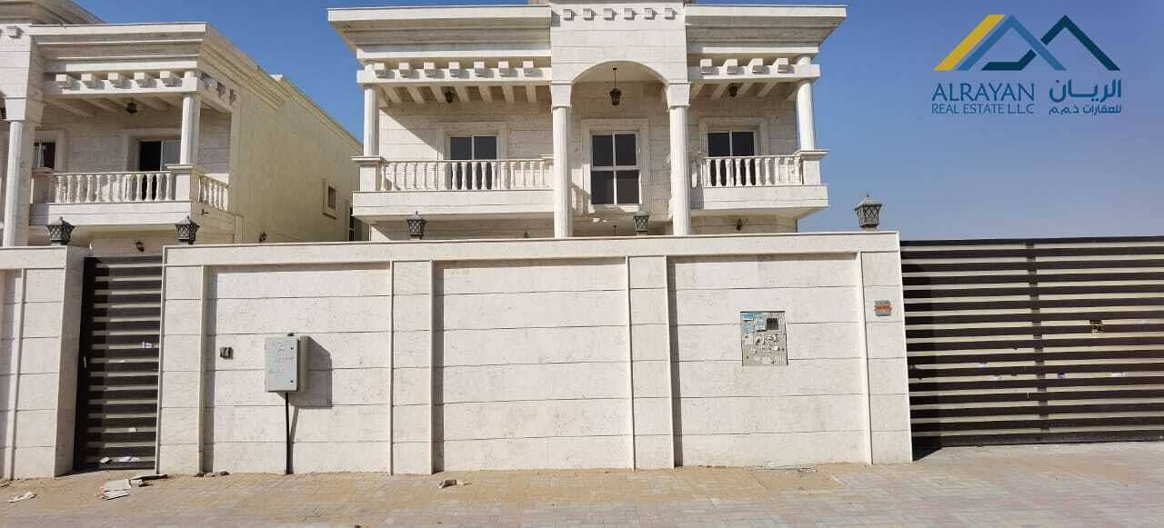 New villa with stone facade, large areas and central air conditioning in Al Mowaihat 1 near Al Tallah Street with the possibility of easy bank financing