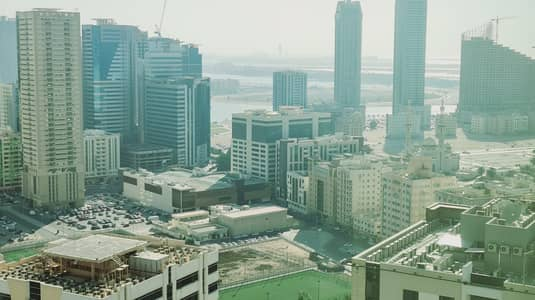 2 Bedroom Apartment for Rent in Corniche Al Buhaira, Sharjah - 50 Days Free Spacious 2BR with Maids Room Balcony Wardrobes and Health Club