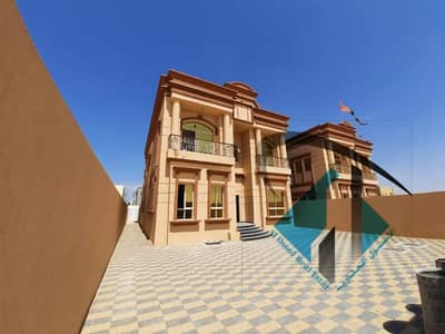 5 Bedroom Villa for Sale in Al Mowaihat, Ajman - A new villa, first inhabitant, finishing a sounding deluxe, a very large area and an attractive price, close to all services, close to all services