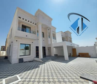 5 Bedroom Villa for Sale in Al Rawda, Ajman - Villa for sale, personal finishing, modern, heritage design, with a full stone face, a very privileged location, close to all services, on a main street, without down payment.