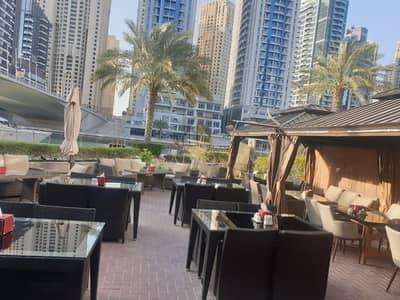 محل تجاري  للبيع في دبي مارينا، دبي - GUARANTEED ROI 10% Occupied Restaurant Marina Walk