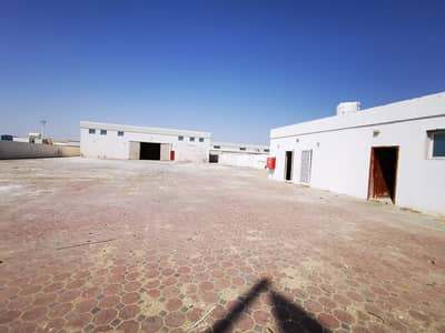 Industrial Land for Rent in Al Saja, Sharjah - 23000 Open Land and Shed 3 Phase Power(35Kw) Office 2 Room Boundary wall In Emirates Industrial City Al Saja Sharjah