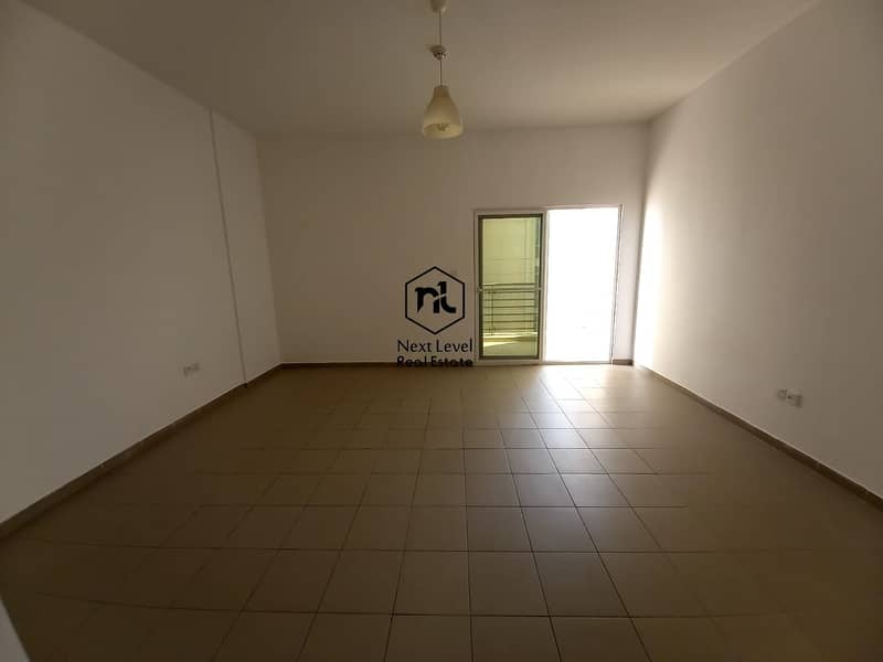 large studio with balcony and parking