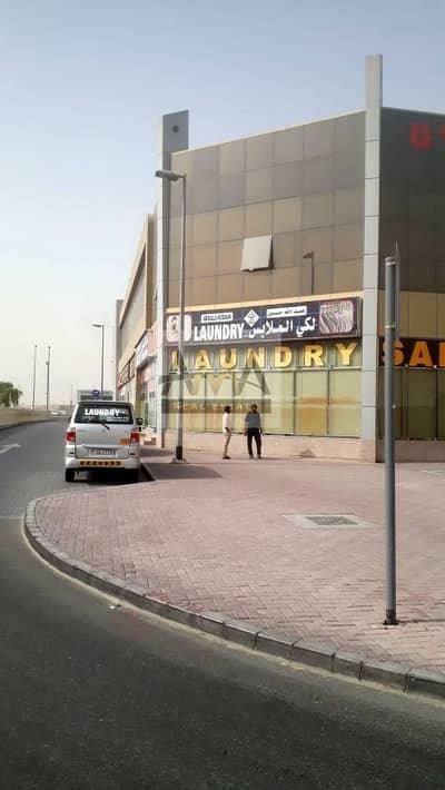 محل تجاري  للايجار في رأس الخور، دبي - Facing Main Road Retail Shop 1325sq.ft 135k