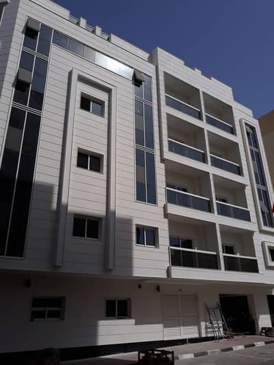 Building for Sale in Al Nuaimiya, Ajman - Residential building for sale with excellent income, great location, fully rented