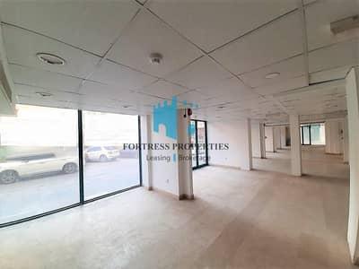 معرض تجاري  للايجار في شارع السلام، أبوظبي - LOW PRICE !! CORNER SHOWROOM nestled in AL SALAM ST |  GF + MEZZ | 4