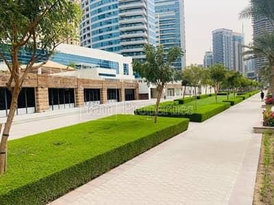 محل تجاري  للبيع في دبي مارينا، دبي - Waterfront retail - long facade - Marina Walk