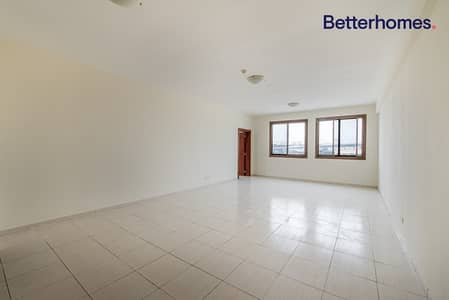 1 Bedroom Apartment for Rent in Jumeirah Village Circle (JVC), Dubai - Community View  Low Floor  Unfurnished   Well Kept