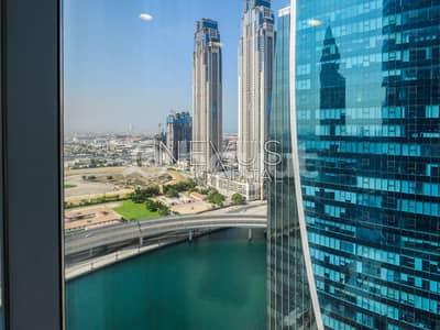 مکتب  للبيع في الخليج التجاري، دبي - Beautiful Fully Furnished Office |  Lake View