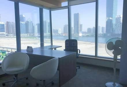 مکتب  للايجار في الخليج التجاري، دبي - Furnished & Partitioned Office with Canal View