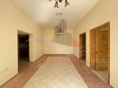 2 Bedroom Flat for Rent in Falaj Hazzaa, Al Ain - Bright Ground Floor Apartment with Shaded Parking
