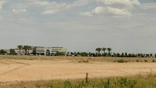 Massive land! Main road of Khalifa City C