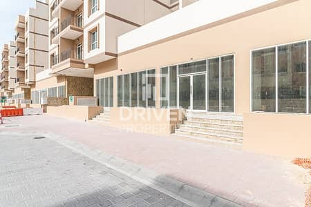 Shop for Rent in Jumeirah Village Circle (JVC), Dubai - Shell and Core Retail Space in May Residence