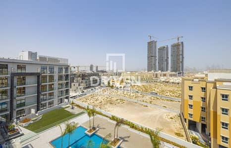 2 Bedroom Flat for Rent in Jumeirah Village Circle (JVC), Dubai - Partly Furnished unit | community view