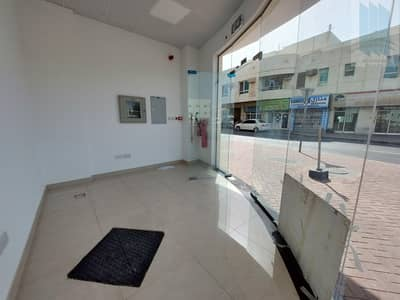 Shop for Rent in Deira, Dubai - Corner shop with spacious footpath  in New building in good location in Hor Al Anz
