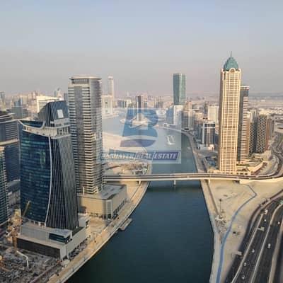 فلیٹ 2 غرفة نوم للبيع في الخليج التجاري، دبي - Investor Deal - Prime Location - Next to Canal and Sheikh Zayed Road - 3 Years Payment Plan Optional