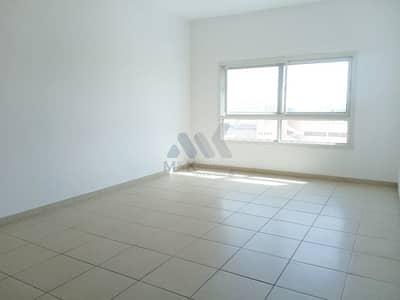 فلیٹ 2 غرفة نوم للايجار في الكرامة، دبي - شقة في بناية همسة A الكرامة 2 غرف 68000 درهم - 5082689