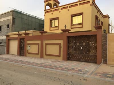 6 Bedroom Villa for Sale in Al Mowaihat, Ajman - I live on the same day of registration in a large villa for the first inhabitant, with personal finishing and in monthly installments of the same value as the rent