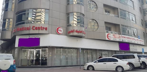 Showroom for Rent in Sheikh Khalifa Bin Zayed Street, Ajman - Large Commercial Area !! Big Showroom Available for Rent Located on the Main Road