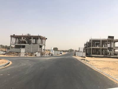 Plot for Sale in Al Zahia, Ajman - We have all sites and areas exempt from all fees, distinctive sites on the streets of Raiseh