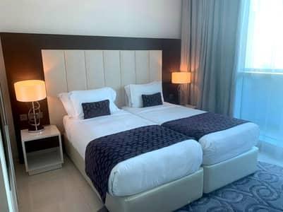 شقة 2 غرفة نوم للايجار في وسط مدينة دبي، دبي - شقة في ذا ديستنكشن وسط مدينة دبي 2 غرف 130000 درهم - 5094258