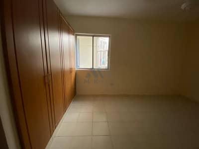 فلیٹ 2 غرفة نوم للايجار في الكرامة، دبي - شقة في بناية الكرامة الكرامة 2 غرف 36500 درهم - 5099883