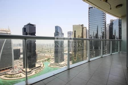فلیٹ 1 غرفة نوم للايجار في أبراج بحيرات الجميرا، دبي - Panoramic Lake Views I Near Metro I Open Kitchen