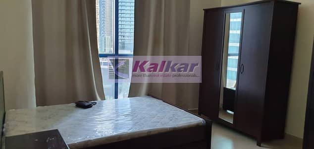 Studio for Rent in Jumeirah Lake Towers (JLT), Dubai - Furnished Studio | Chiller Fee | Lake View | Lower Floor | Ready to Move In