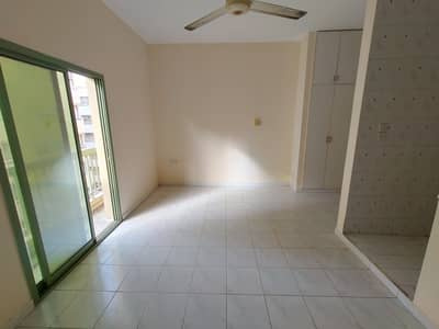 Studio for Rent in Al Nabba, Sharjah - Very Spacious STUDIO APARTMENT WITH Separate Kitchen Wardrobe Balcony No Deposit Family Building