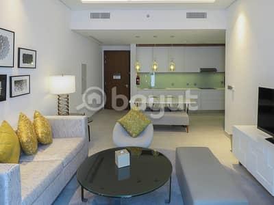 3 Bedroom Hotel Apartment for Rent in Al Garhoud, Dubai - Living room + kitchen