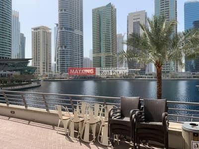 محل تجاري  للايجار في أبراج بحيرات الجميرا، دبي - Fitted Shop with Excellent Lake view For Rent in JLT