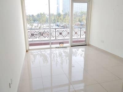 شقة 2 غرفة نوم للايجار في قرية جميرا الدائرية، دبي - شقة في بناية رويال JVC قرية جميرا الدائرية 2 غرف 65000 درهم - 5109774