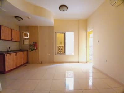 Studio for Rent in Al Mujarrah, Sharjah - Spacious Studio With balcony Split ac Central Gas  close to park near to cornisch