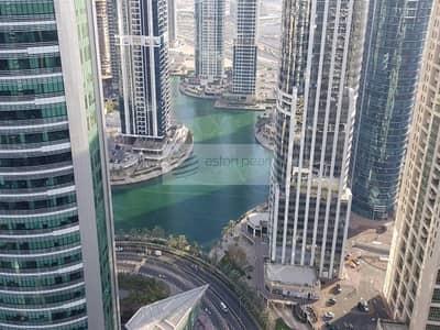 شقة 1 غرفة نوم للايجار في أبراج بحيرات الجميرا، دبي - Full Furniture | 1BR on a High Floor | Lake View
