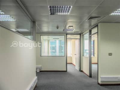 Office for Rent in Deira, Dubai - Partitioned and Fully Fitted | Chiller Free | Prime Location | with Nice Exterior View