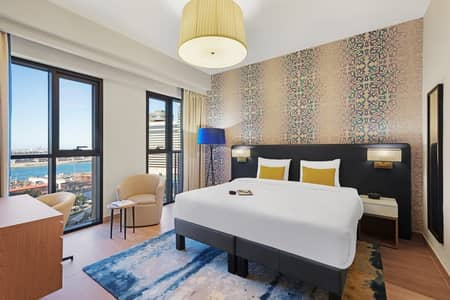 Hotel Apartment for Rent in Deira, Dubai - Premium Studio at Palm Deira Island @5099/Monthly  Fully Furnished   Free DEWA/WIFI (GS-AD0020)
