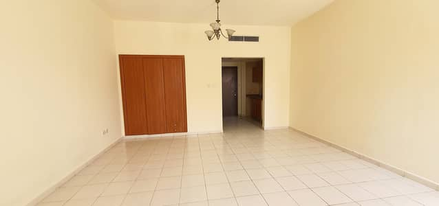 Studio for Rent in International City, Dubai - STUDIO   For Rent  WITH BALCONY  ONLY 18,000 By 2 Cheque's