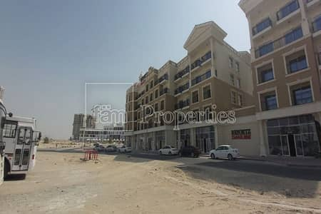 Shop for Rent in Arjan, Dubai - Shell & Core Retail Space with High Ceiling