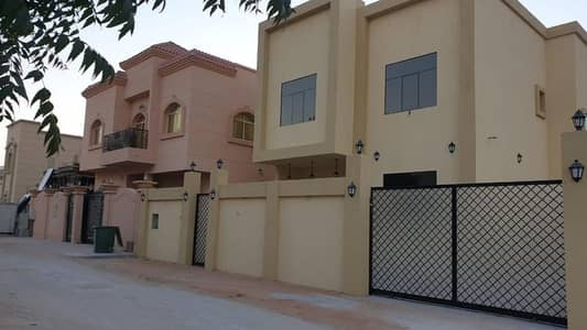 4 Bedroom Villa for Sale in Al Helio, Ajman - Villa for sale on the neighboring street, super deluxe finishing, freehold for all nationalities, stone facade